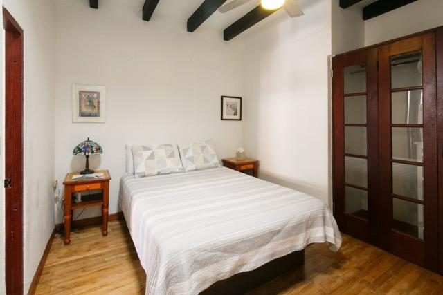 bedroom with queen size bed and twin size futon