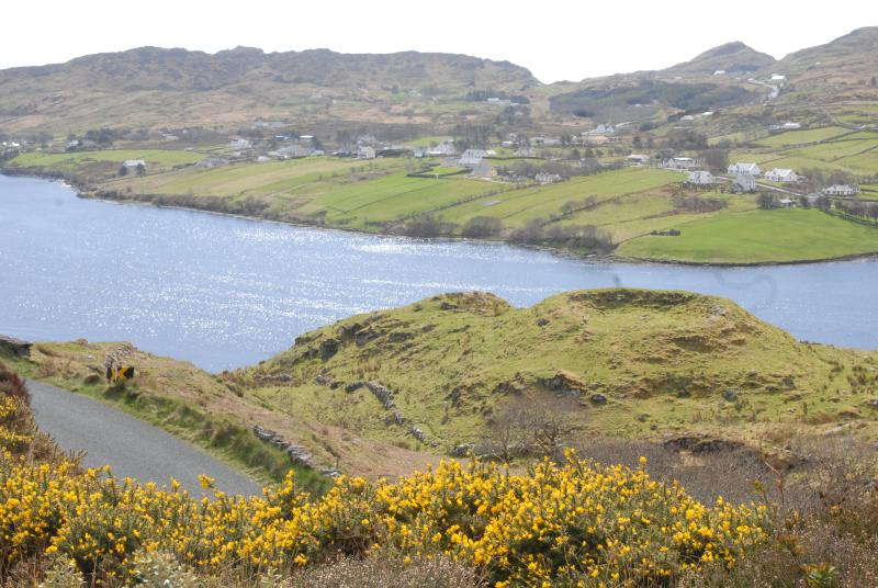 View from Garden. A fort overlooks Teelin bay and Slieve Liage in the background