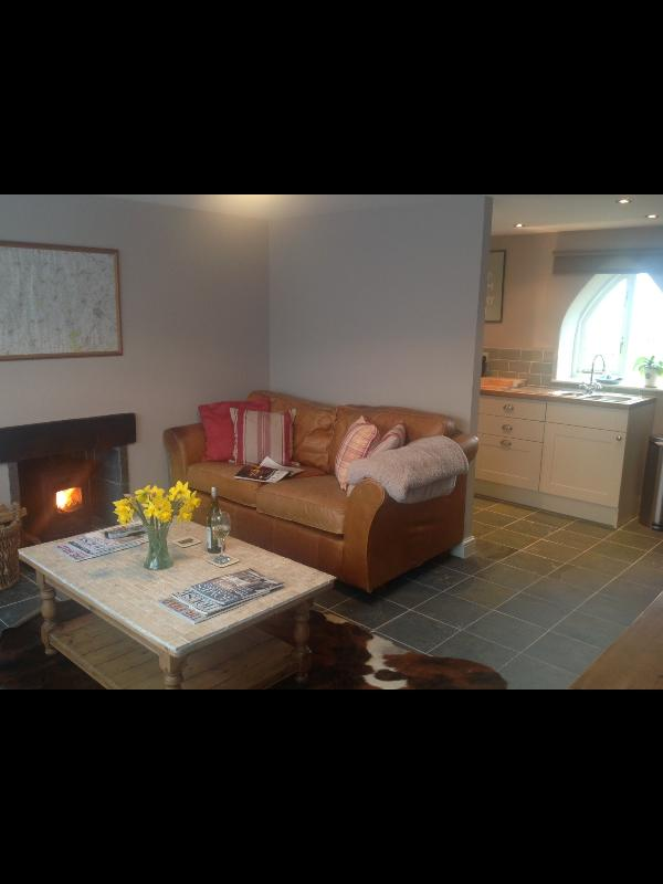 Cosy living room with large sofa, wood burner, Sky tv and Wifi