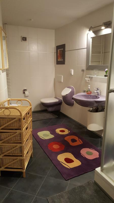 Bathroom with shower and floor heating