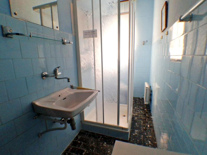 Bathroom with shower and toilet.