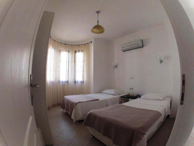 Una de las habitaciones camas
