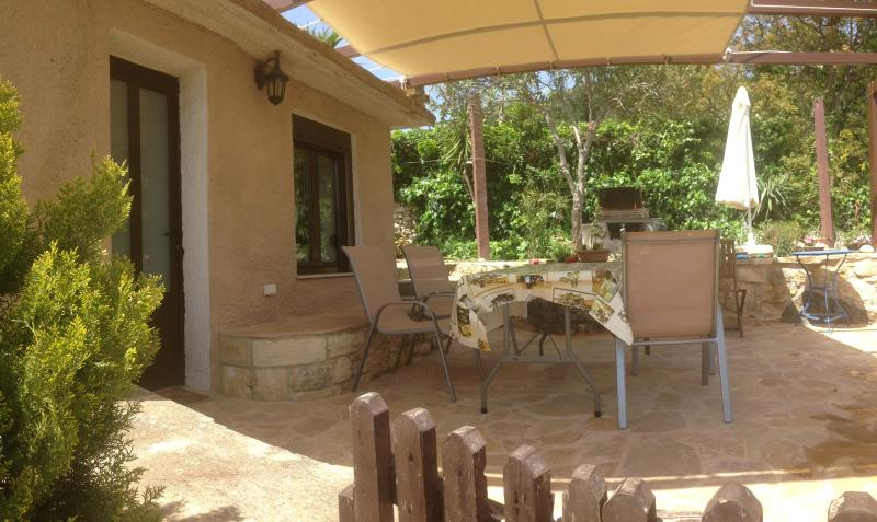 Veranda with the big table next to kitchen