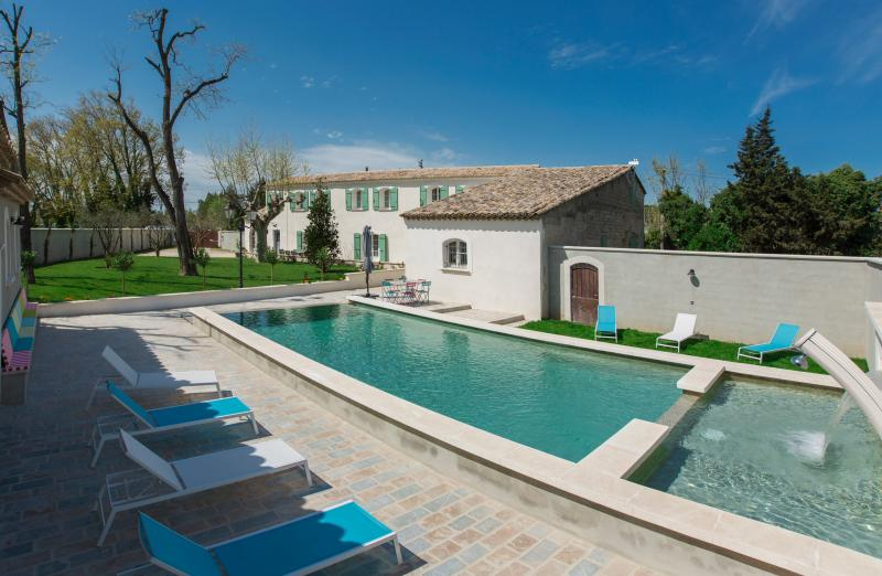 Panoramic view of the farm house in the heart of Provence with the garden and swimming pool.