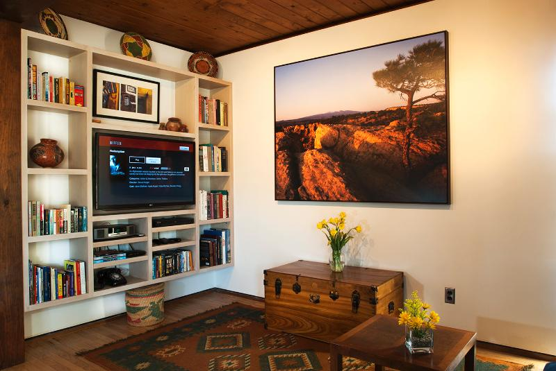 The open study has a flat screen TV for additional entertainment.