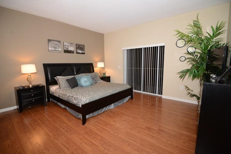Master bedroom with large flat screen TV and DVD player