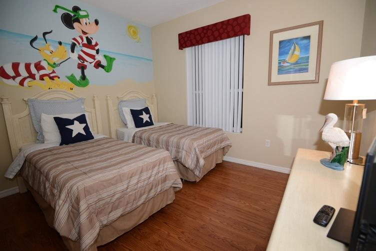 Mickey theme room with twin double beds, large flat screen TV and DVD player