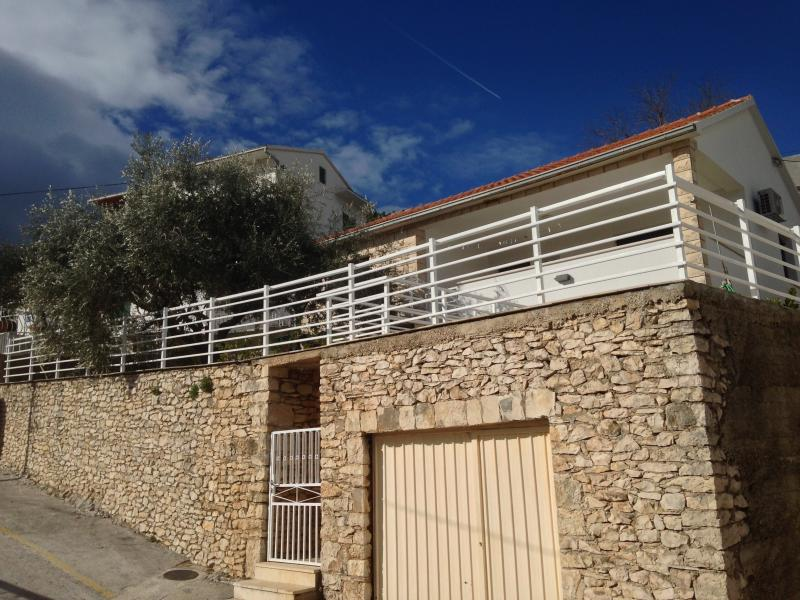External view of the property, private garage, two stone terrace, private mediterranean gardenrd