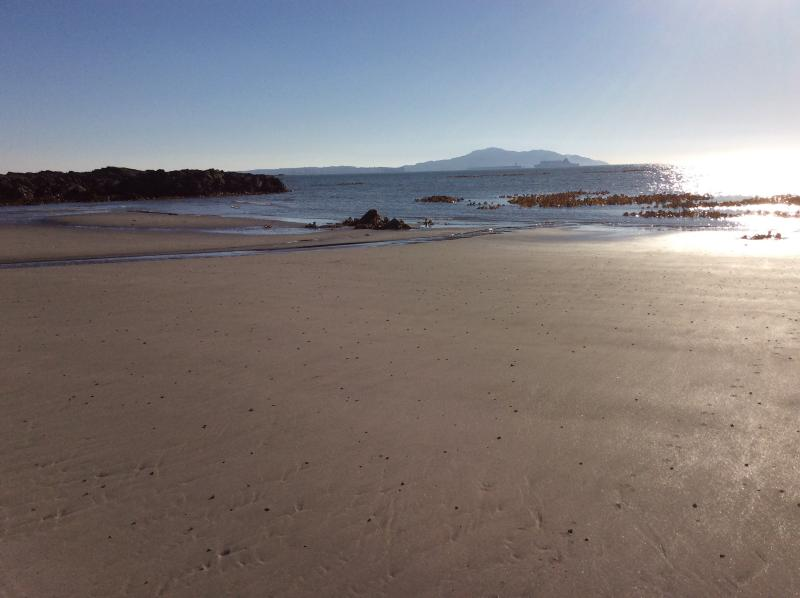 Trefadog beach at low tide, view towards Holyhead and incoming Ferry