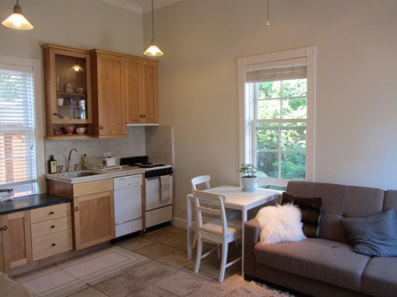 Complete kitchen with four burner stove, dishwasher and disposal, 3/4 size fridge, microwave.