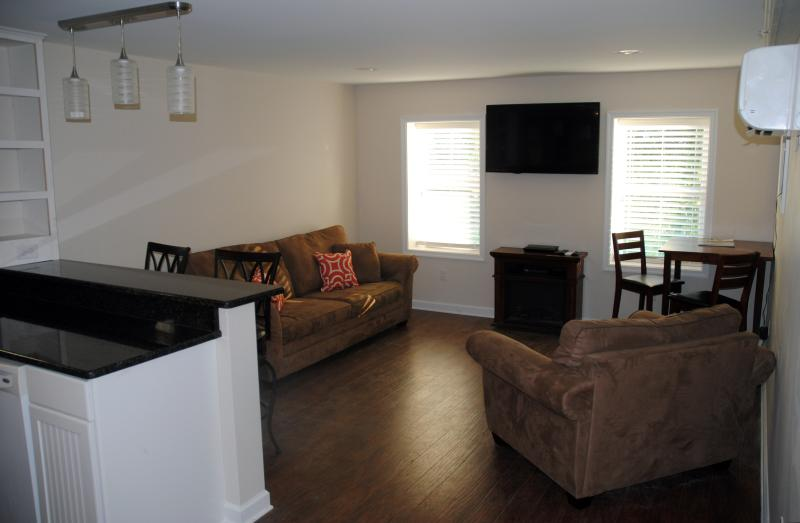 Living Area with pull-out sleep sofa and pub style table overlooking Main Street