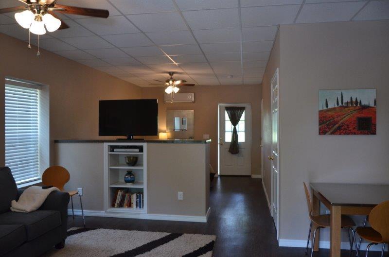 View from front door to back door.  King bedroom is behind privacy wall.TV rotates between rooms