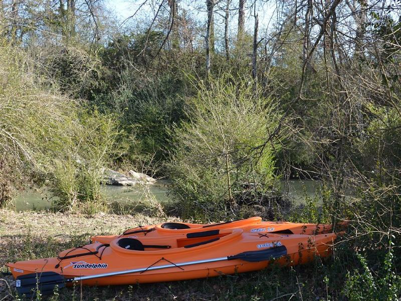2 kayaks, paddles, and adult life jackets ready for you at the creek.