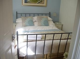 Double bedroom with feather duvets and lovely white cotton sheets