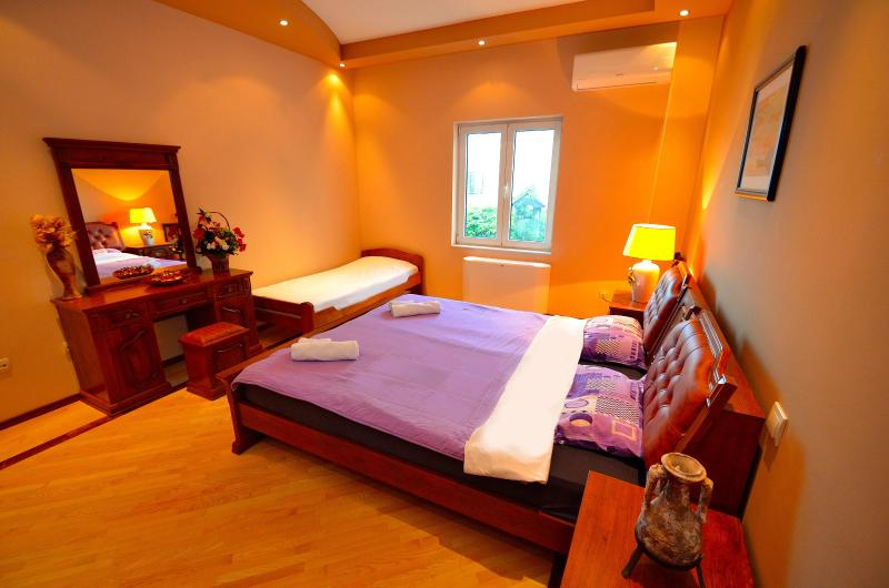 Main bedroom with one french-double bed and one single bed
