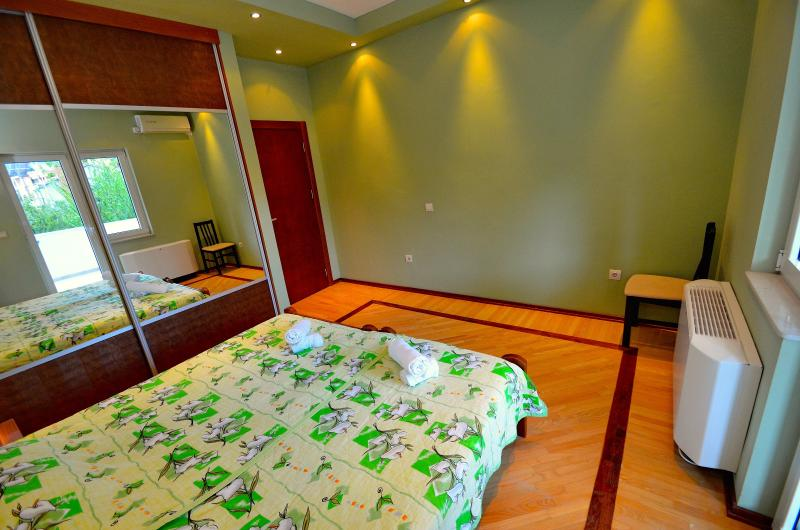 Second room with entrance on the balcony, big wardrobe and two single beds
