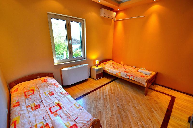Third room has two single beds
