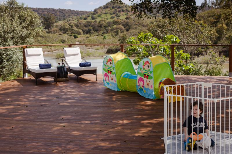 Large deck with shade and views of the river and hills