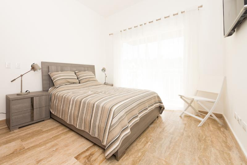 A cool mountain'breezy'queen bedroom. Outfitted with Italian furniture.