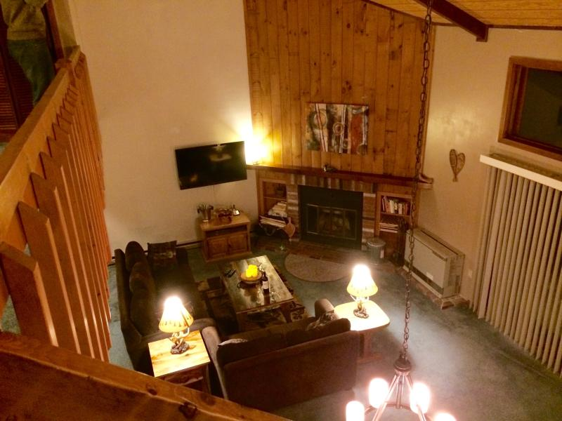 View of living area from the stairs which lead to the two bedrooms.