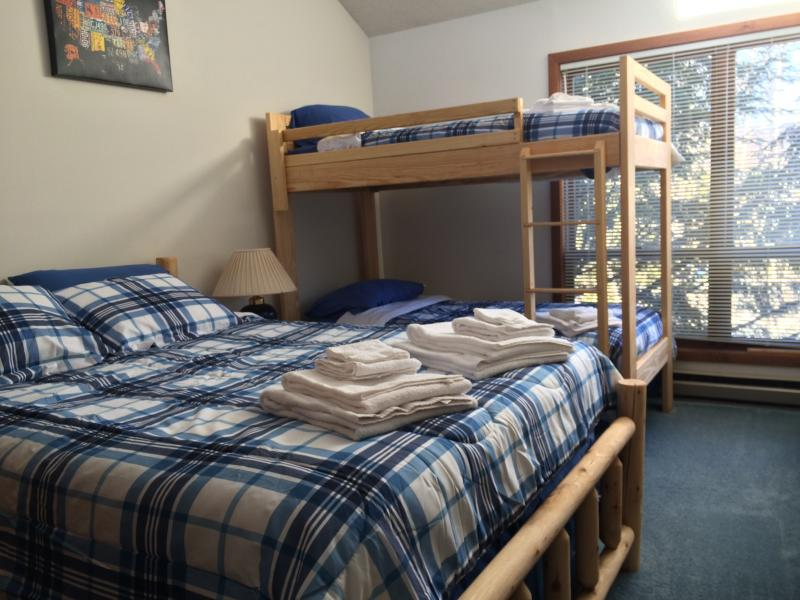 One of two bedrooms.  This one has a queen sized bed, with bunks and en-suite bath.