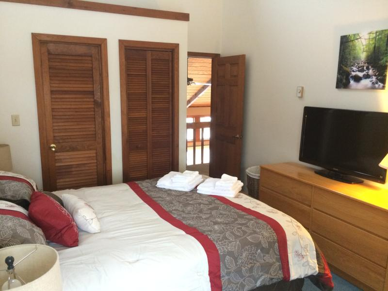 Master bedroom with king sized bed and en-suite bathroom.