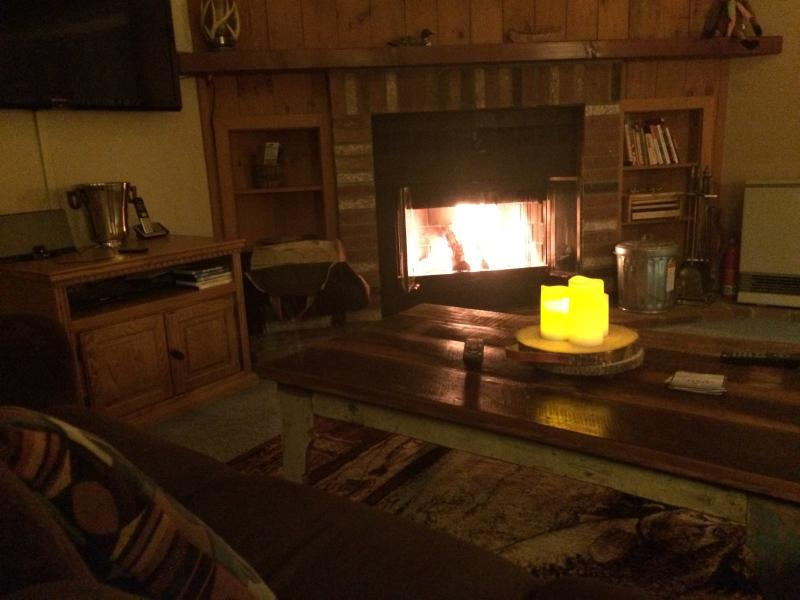 Enjoy the wood burning fireplace after a long day exploring the White Mountains,