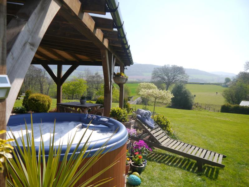 Relax in the hot tub and enjoy the wonderful views of the Black Mountains.