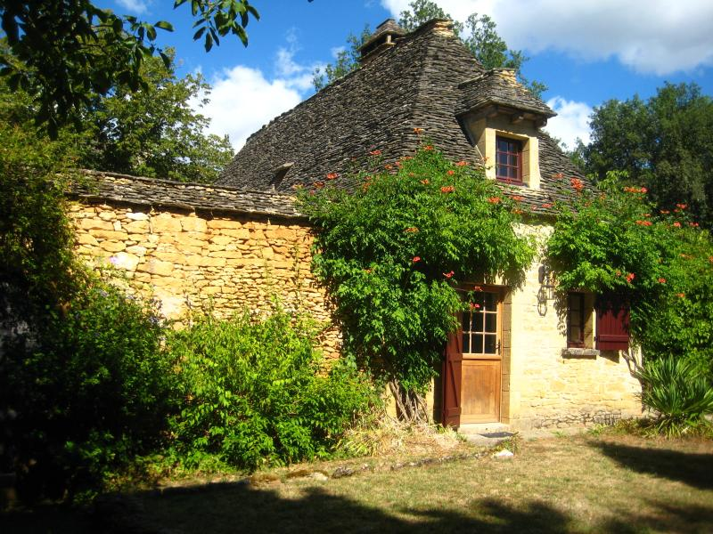 Traditional stone cottage with 'Lauze' roof