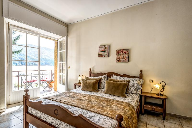 master  bedroom with French doors to your private balcony and lake views