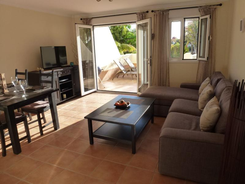 Open plan living, dining area and patio doors to terrace and pool beyond