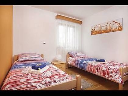 H(8+2) : chambre à coucher