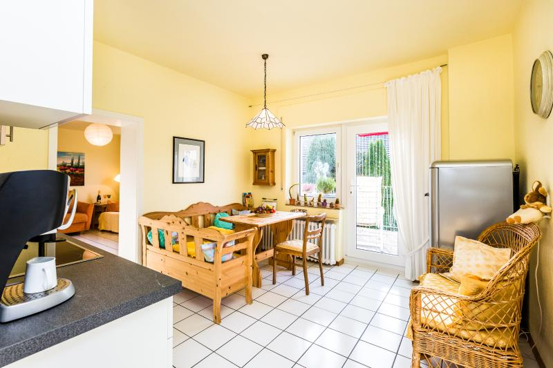Eat-in kitchen with a cozy corner seat and access to the balcony