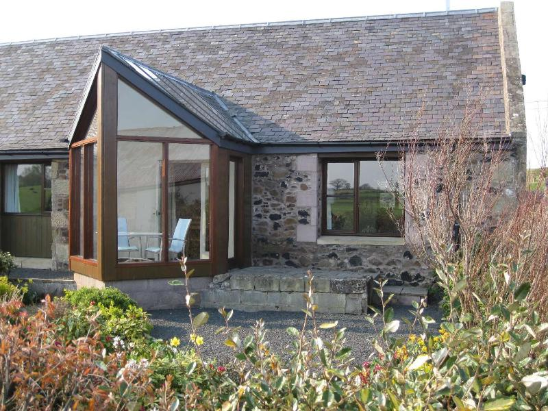 Thairn south facing patio, magnificent views over cottage garden, Eden Water to Cheviot Hills.