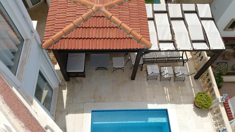 Shade from the sun, Turkish pergola and poolside dining