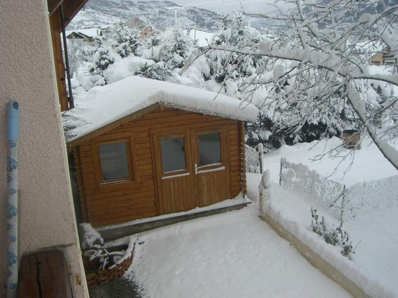 Chalet and garden in the snow