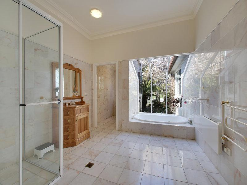 Spacious Italian marble bathroom, leadlight windows, vanity, shower, sunken bathtub