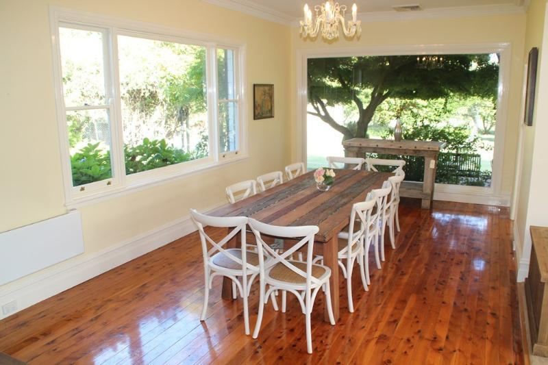 Stunning formal dining room overlooking garden and tennis court
