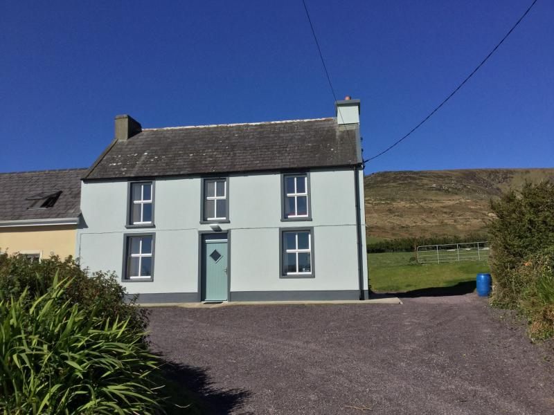 A semi-detached refurbished farmhouse set in a quiet location, between the hills and sea.