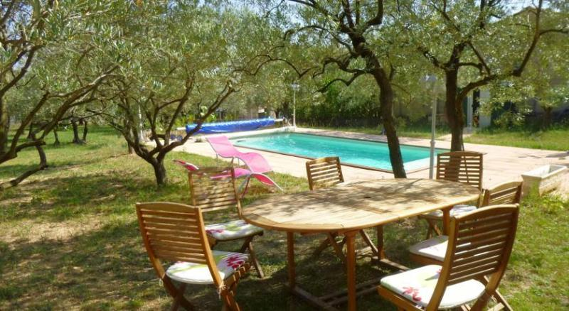 Olive grove garden with swimming pool and lounge access.