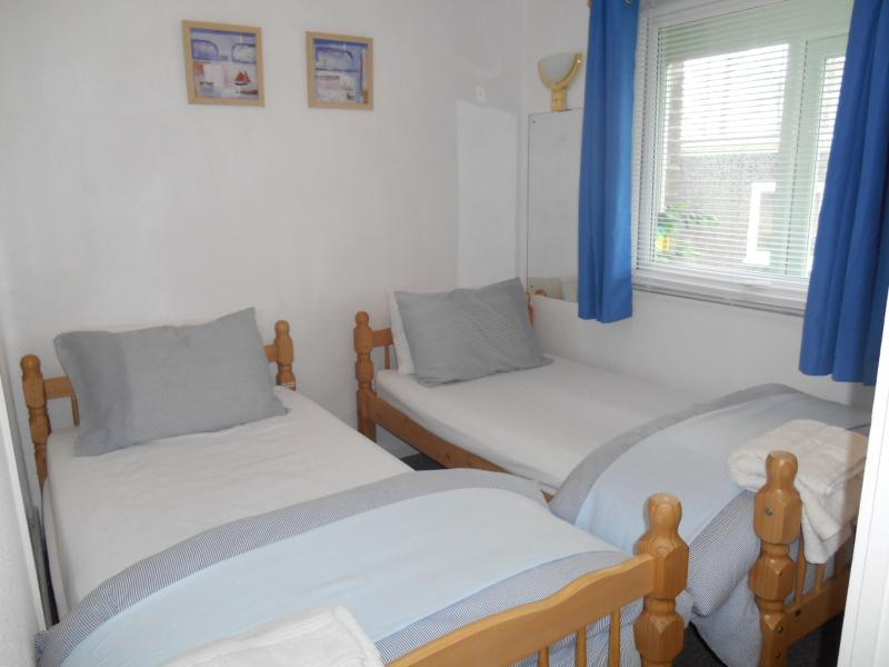 Bedroom with full sized twin beds and wardrobe