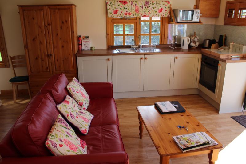 Kitchenette containing washing machine, fridge and cooker