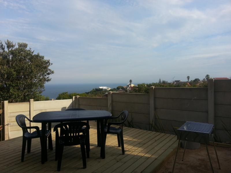 Outside deck with braai and sea view.