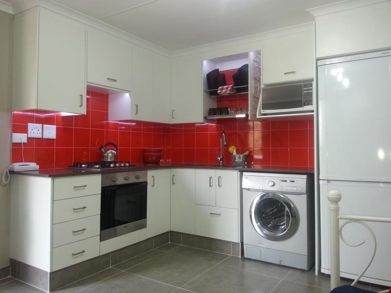 Fully equipped kitchen with washing machine, fridge, oven and appliances
