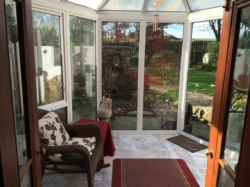 Conservatory provides a handy sun-trap overlooking the garden