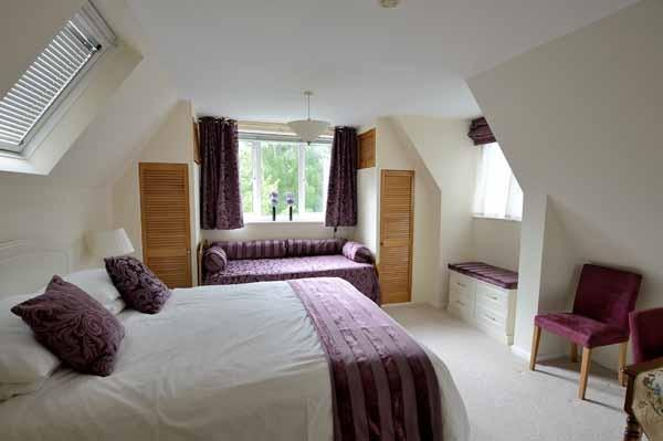 Upstairs bedroom: double bed plus additional single bed (on request).