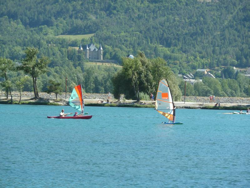 Windsurfing and canoeing on the Serre Poncon Lake
