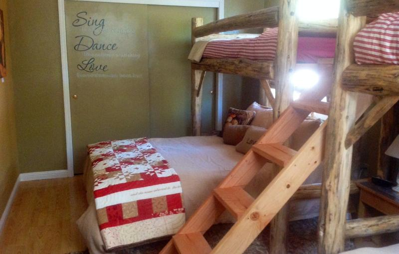 First guest bedroom, two single log beds over two queen log beds.