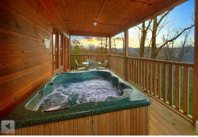 Relax in the Hot Tub overlooking a beautiful  mountain!! Mountain views vary depending on season!