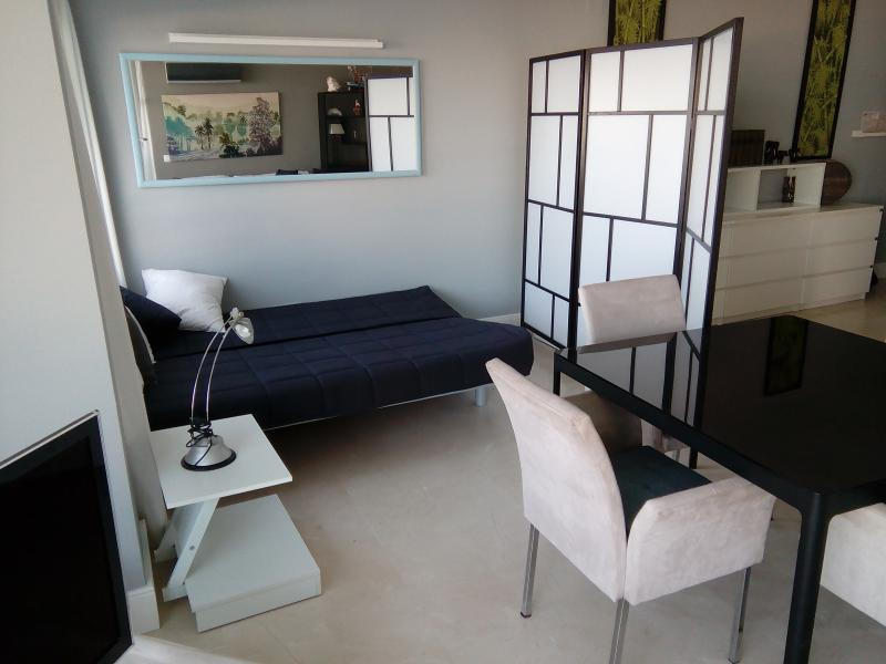 Sofa bed with folding screen